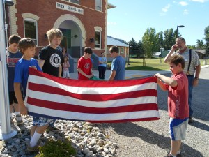 Students learn about retiring the US Flag from a community member.